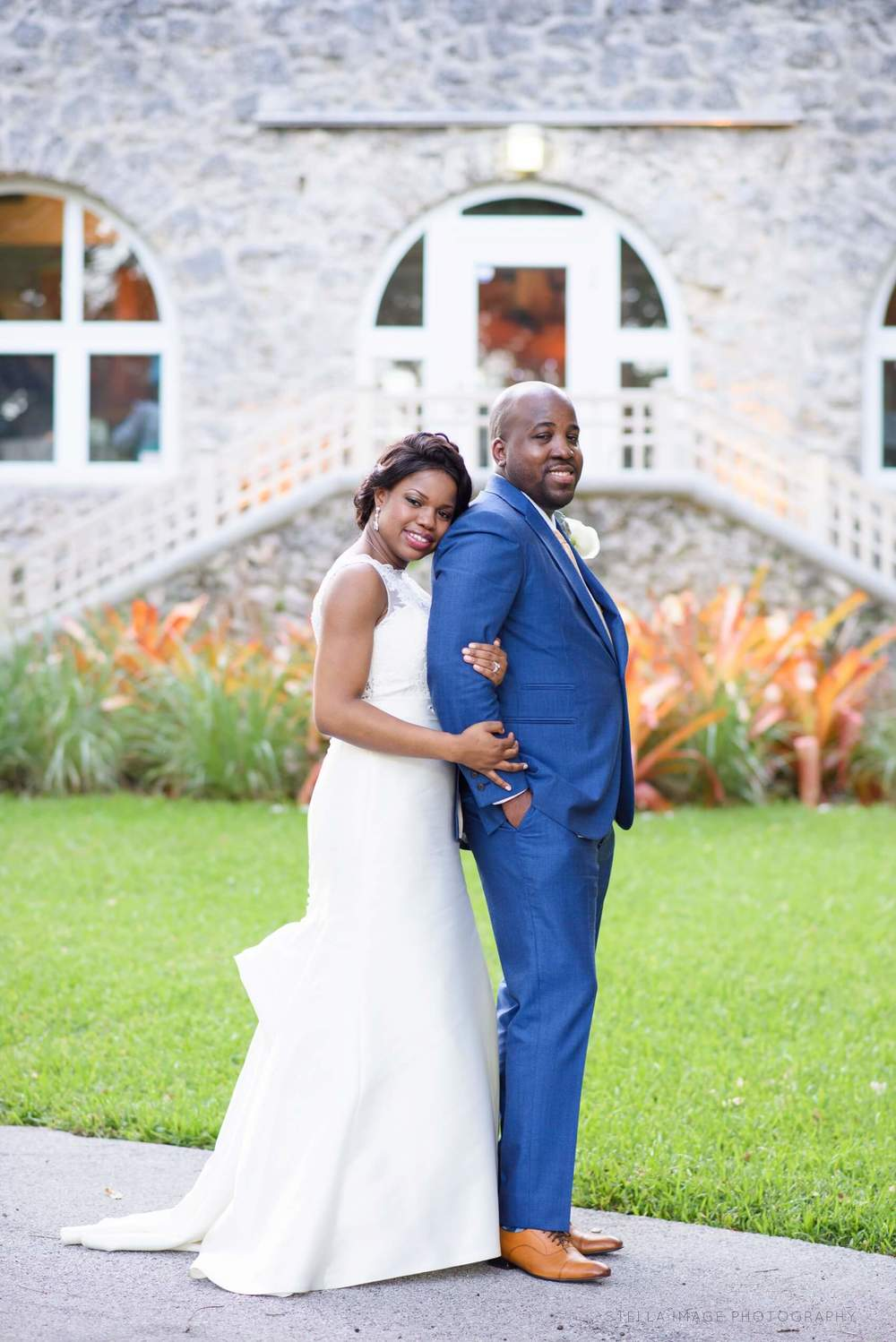 Bride Oluchi holds arm of Groom Marvin in front of the Woman's Club of Coconut Grove.
