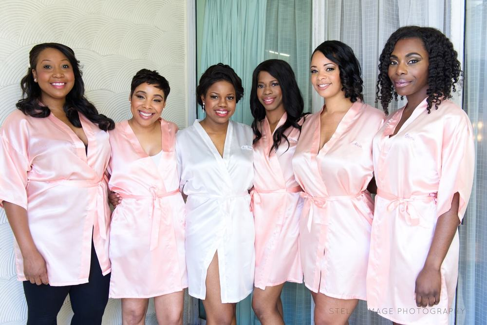 Bridesmaids in silk robes, getting ready at the Mutiny Hotel in Coral Gables.
