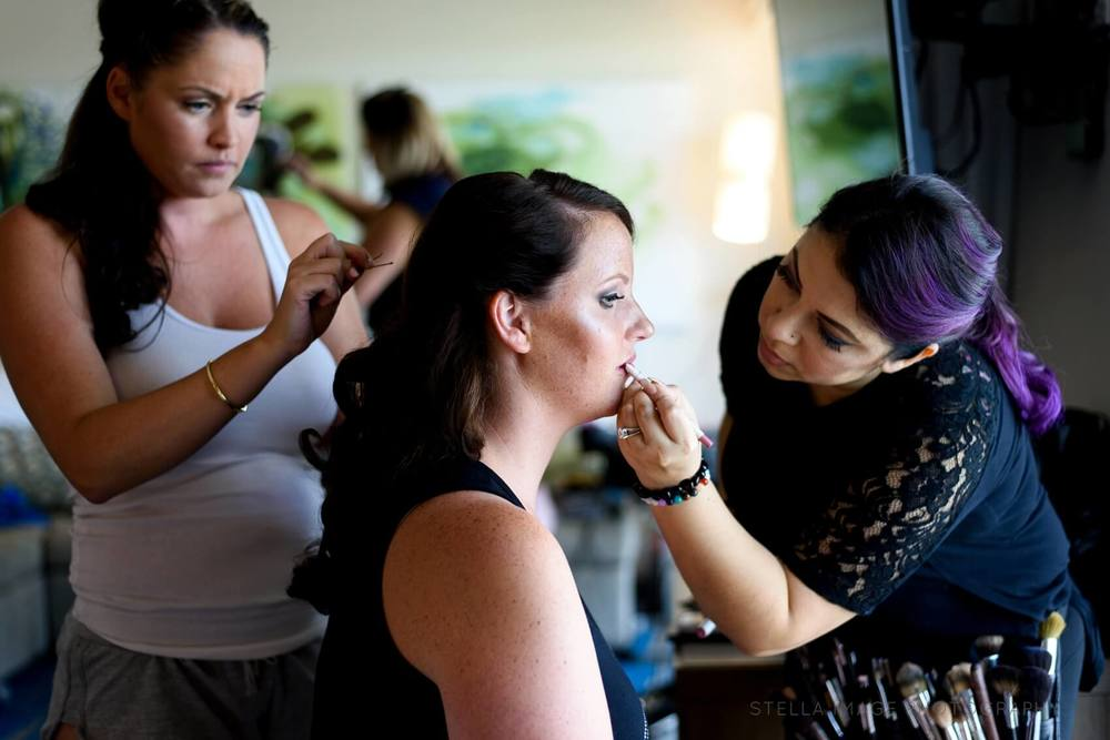 Bride gets her hair and make up done.