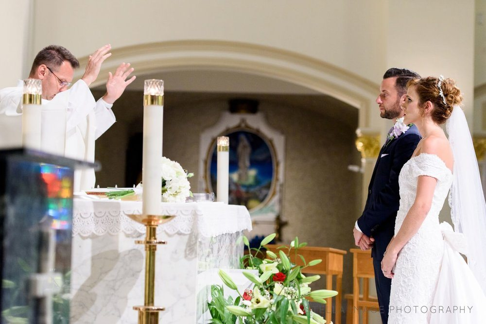 Priest blesses couple.